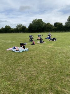 Buggy fitness class outside in sunshine